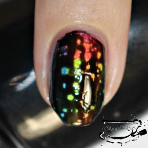 """Macro"" of topcoated Black Spotted mani in artificial light"
